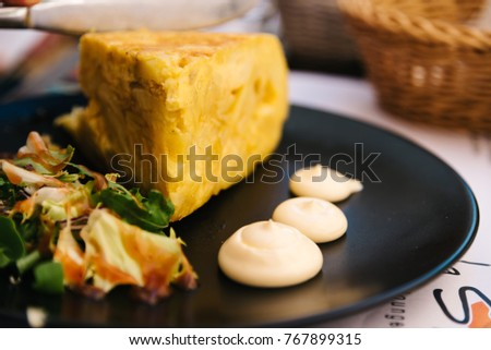 Spanish omelette with mayonnaise in restaurant in the old city of Cordoba #767899315