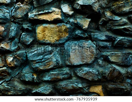 Old monastery wall made of big rocks covered by worn out blue paint 3d texture, background