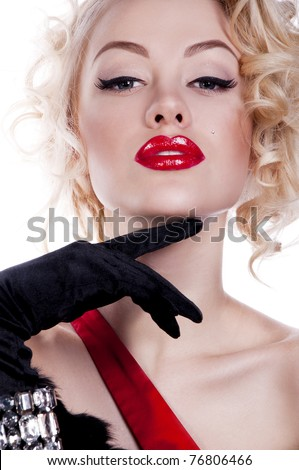 Pretty blond girl model like Marilyn Monroe in red dress with red lips on white background