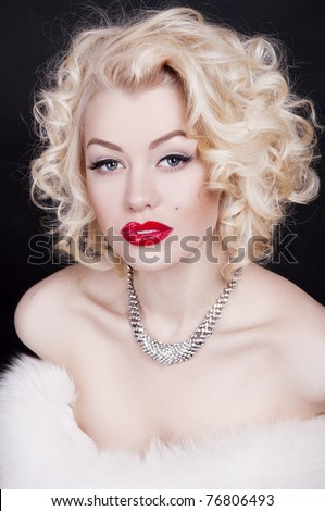 Pretty blond girl model like Marilyn Monroe with red lips on black background