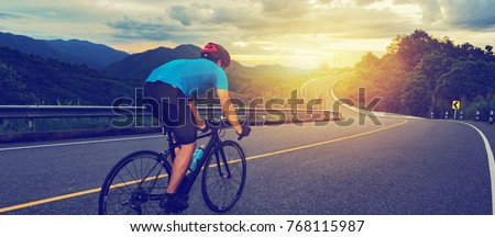 Cycling competition,cyclist athletes riding a race at high speed on mountain road, Sportsmen bikes in the morning,vintage color,selective focus, sports concept,low angle view,Business competition #768115987