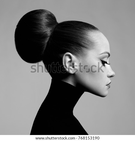 Black and white fashion art studio portrait of beautiful elegant woman in black turtleneck.  Hair is collected in high beam.  Elegant ballet style #768153190