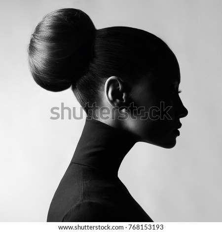 Black and white fashion art studio portrait of beautiful elegant woman in black turtleneck.  Hair is collected in high beam.  Elegant ballet style #768153193