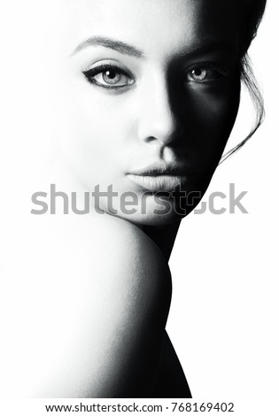 High contrast black and white portrait of a beautiful girl. #768169402