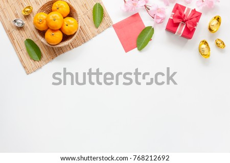Flat lay of accessories Chinese new year and decorations Lunar new year festival concept background.Difference items on modern white wooden at office.Other language mean rich or wealthy and happy. #768212692