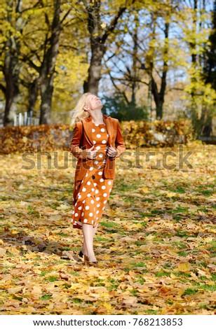 Pretty Young Woman Walking in Park, Beautiful Brown Dress, Autumn Fall, Sunlight #768213853