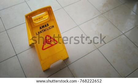 "Bertam, Penang Malaysia - November 11th 2017 : ""Awas Lantai Licin"" signboard on wet floor during heavy rain. #768222652"