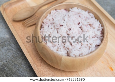 Bowl with brown rice on wooden tray #768251590