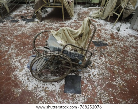 """Bondeno, Italy - December 2, 2017. Art installation """"The silent scream of Chernobyl"""".  Reconstruction of the civil hospital after the atomic tragedy.  Wheelchair. #768252076"""