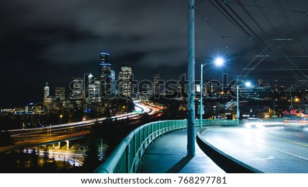 Long exposure of traffic going through downtown Seattle #768297781