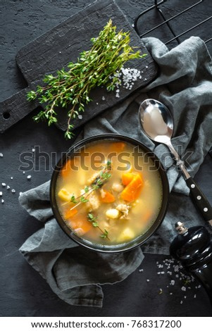 Fresh fish soup in bowl on black background, top view #768317200