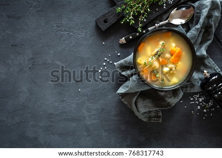 Fresh fish soup in bowl on black background, top view #768317743