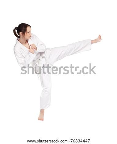 full-length isolated portrait of beautiful martial arts girl in kimono excercising karate kata kick #76834447