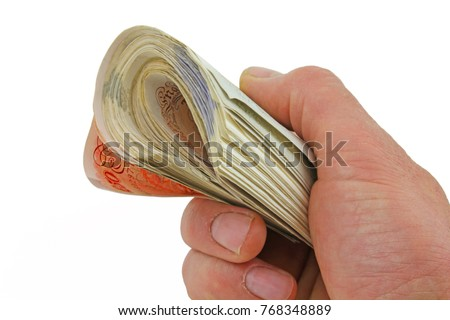 Money notes – A male hand holding a large amount of sterling pound notes isolated on a white background  #768348889