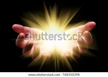 Woman hands cupped holding, showing, or emanating bright, glowing, radiant, shining light. Emitting rays or beams expanding. Religion, divine, heavenly, celestial concept. Black background, front view #768350398