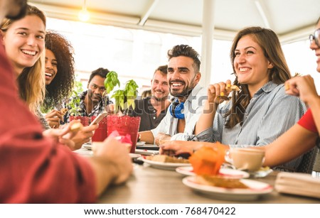 Friends group drinking cappuccino at coffee bar restaurant - People talking and having fun together at fashion cafeteria - Friendship concept with happy men and women at cafe - Warm vintage filter  Royalty-Free Stock Photo #768470422