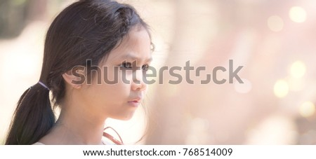 International women day concept: Close up asian girl over blurred sunset background #768514009