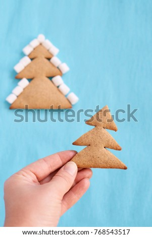 Christmas tree biscuits. White marshmallow. Blue background. #768543517