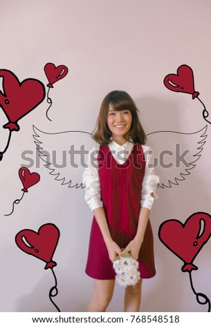 Valentines day and love story concept: young asian woman with cupid angel wings and heart balloons flying on the background