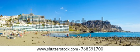 Beautiful beach of Playa del Cura, near Playa Amadores, Puerto Rico town, Gran Canaria, Canary Islands, Spain. Royalty-Free Stock Photo #768591700