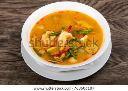 Tom Yam soup - Thai cuisine with shrimps #768606187