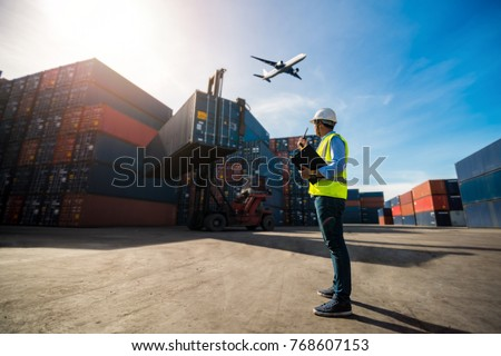 Foreman control loading Containers box to truck for Logistic Import Export Background, Business logistic concept, import and export concept #768607153