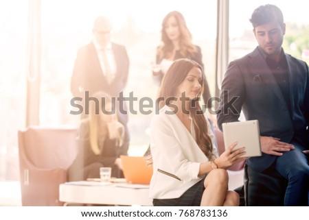 Business meeting at a modern glass corner office #768783136
