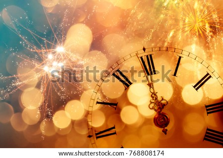 New Year's at midnight - Old clock with stars snowflakes and holiday lights #768808174