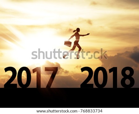 Men jump over silhouette Happy New Year 2018 #768833734