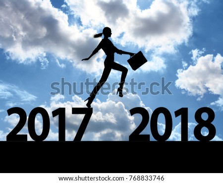 Men jump over silhouette Happy New Year 2018 #768833746