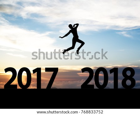 Men jump over silhouette Happy New Year 2018 #768833752