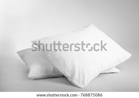 Blank soft pillows on light background #768875086
