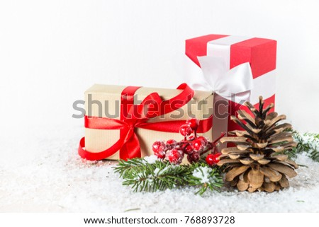 Christmas background or greeting card. Christmas present box, pine cone and decorations on white. Isolated. #768893728