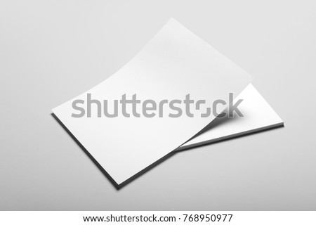 Real photo, blank letterhead, flyer, poster template. Isolated on grey background to place your design.  Royalty-Free Stock Photo #768950977