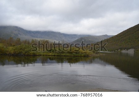 Lake small Vudyavr in the mountains of the city of Kirovsk (Khibiny) #768957016