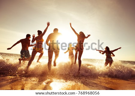 Big crowd of people having fun at sunset beach #768968056