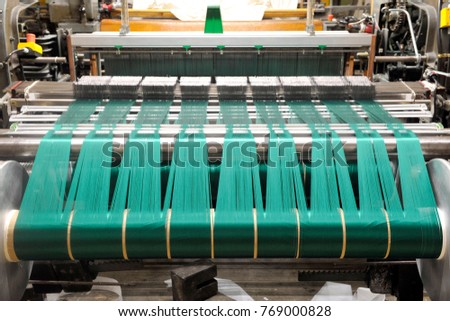 Textile industry with knitting machines in factory - italian - made in Italy  #769000828