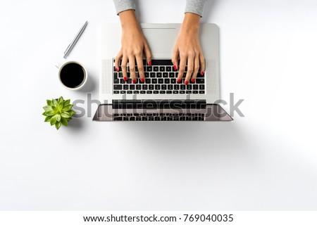 Female hands working on modern laptop. #769040035