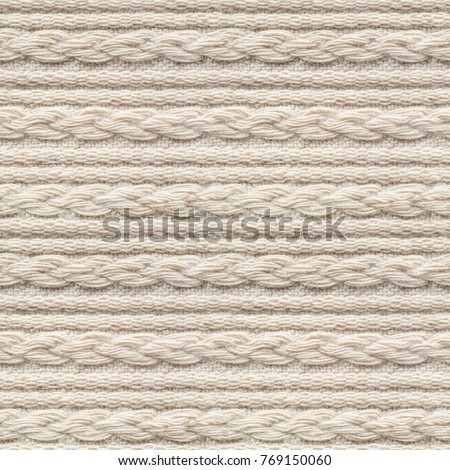 Seamless Beige Knitwear Fabric Texture with Pigtails. Repeating Machine Knitting Texture of Sweater. Beige Knitted Background.