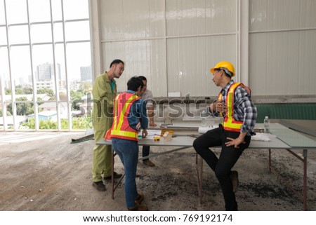 Engineer group asia and worker meeting, discussion with construction on site work in friendly atmosphere joking and having fun during working process #769192174