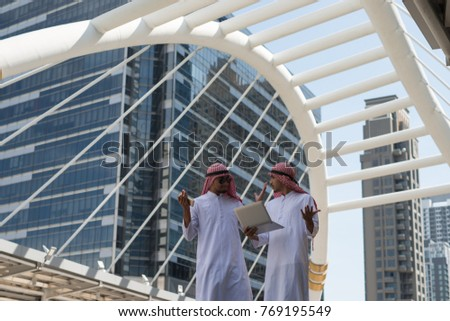 Two Arab businessmen consult to work together for a common goal and success city Background.Business Concept #769195549