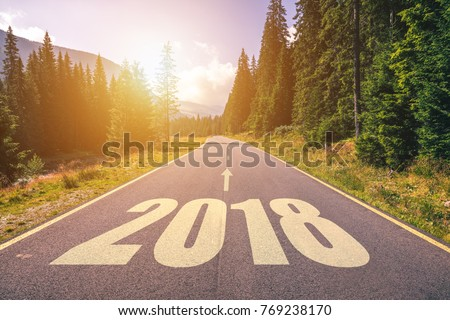 Empty asphalt road and New year 2018 concept. Driving on an empty road in the mountains to upcoming 2018 and leaving behind old 2017. Concept for success and passing time. #769238170