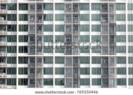 Apartment windows showing a new high rise condo with good real estate rentals and spaces to buy #769250446