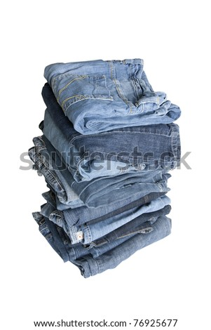 folded jeans in a pile on a white background #76925677