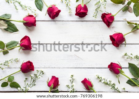 Red roses on wooden board background with copy space #769306198