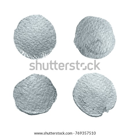 Silver glitter paint brush circle stains set or abstract dab smear smudge texture on white background. Isolated glittering silver paint ink splash stain for luxury greeting card design template #769357510