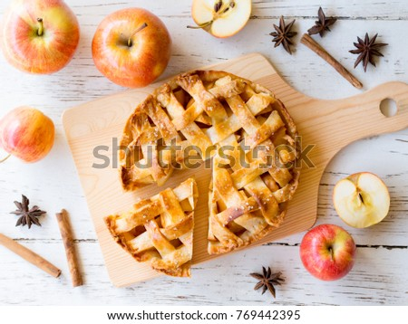 Homemade apple pie pastry on wooden board in top view.,bakery and dessert concept. Royalty-Free Stock Photo #769442395
