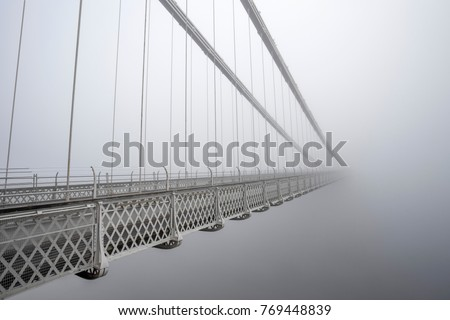 Clifton Suspension Bridge in the thick fog. Royalty-Free Stock Photo #769448839