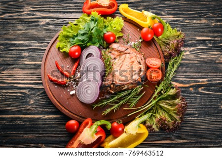 Grilled Steak, with Vegetables. Pork, veal, meat. On a wooden background. Top view. Free space for text. #769463512