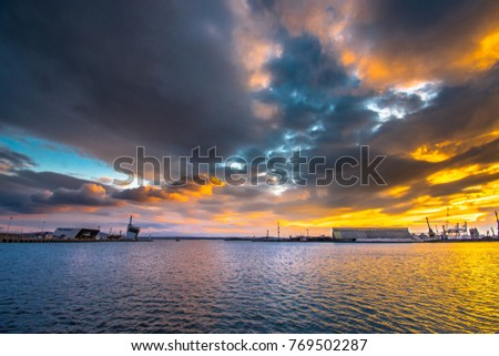 Beautiful cloudy winter sunset over the sea #769502287